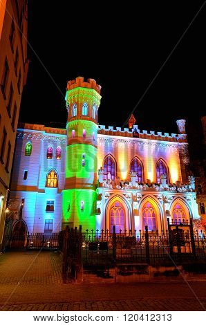 Small Trade Guild Building In Old Riga. Illuminated During Christmas