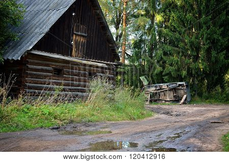 Old abandoned village scene in Russia. Old cottage house.