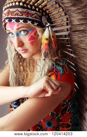 The Beautiful Modern Young Girl In The Native American Suit