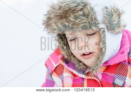 Closeup Half-turned Portrait Of Little Girl With Closed Eyes