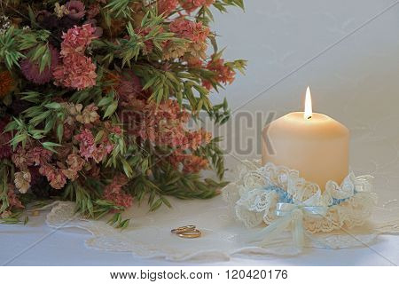 Wedding set up with a candle and two rings