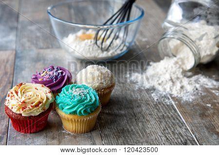Cupcakes in front of baking utensils