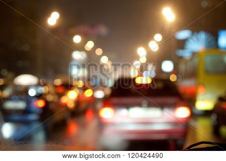 Night traffic jam in the city. Blurred bokeh postcard.
