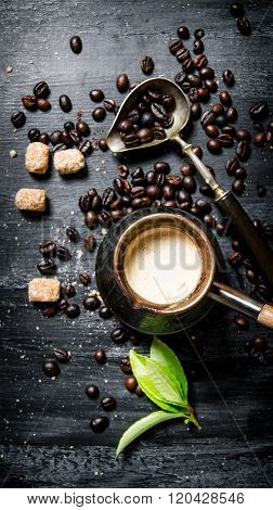 Coffee Pot With Coffee Beans, Cane Sugar And Fresh Leaves.