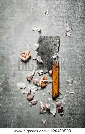 Fragrant Cloves Of Garlic And A Large Hatchet.