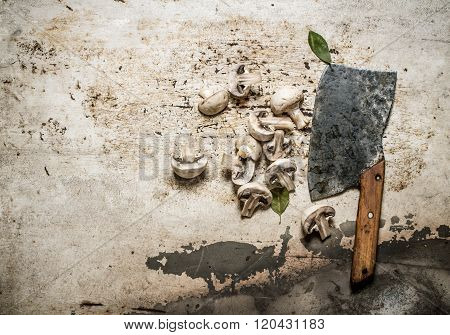Sliced Mushrooms With Spices And A Large Hatchet.