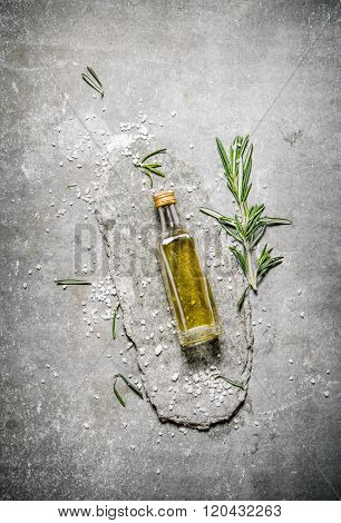 Olive Oil In Bottle With Rosemary And Salt.