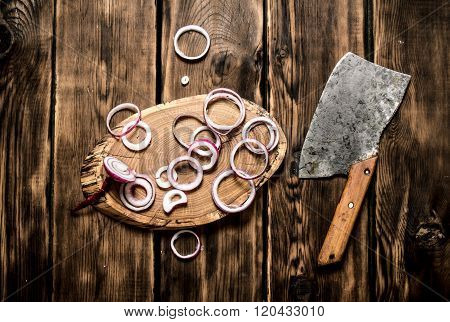 Onion Sliced Old Hatchet. On Wooden Background.