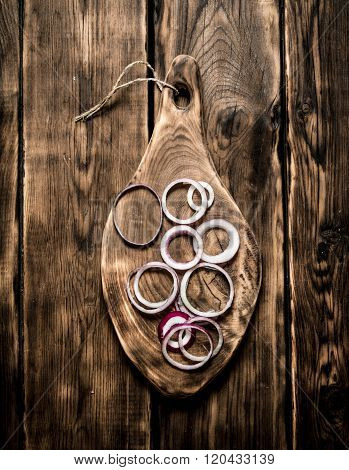 Rings Of Sliced Onion On The Board.