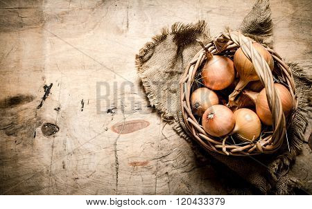 Fresh Onion In An Old Basket.