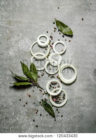 Onion Rings With Spices And Bay Leaves.
