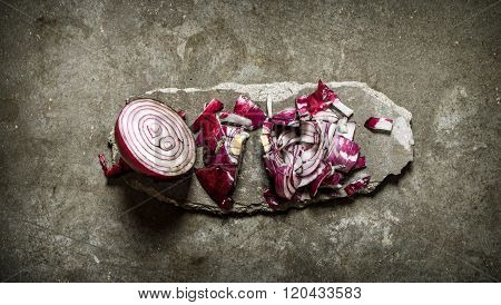 Sliced Red Onion On A Stone Stand.