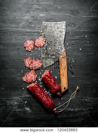 Sliced Salami With Spices And A Hatchet.