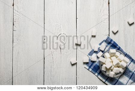 White  Sugar In Cup On The Napkin.
