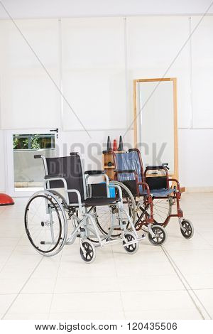 Two empty wheelchairs as symbol for euthanasia in nursing home