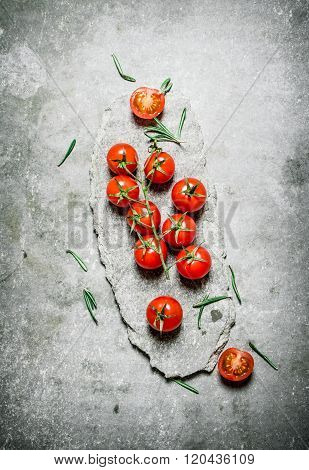 Red Tomatoes On A Stone Stand.