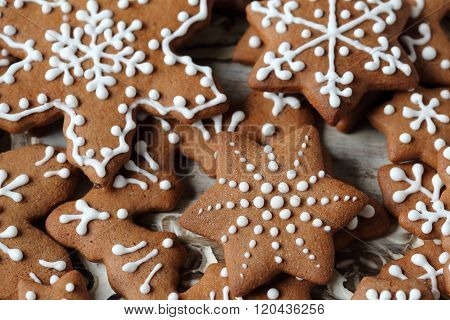 Christmas homemade gingerbread cookies on wooden table. ** Note: Shallow depth of field