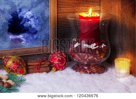 Christmas Decoration With Candles At The Window
