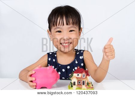 Asian Little Chinese Girl Saving Money For Property Concept