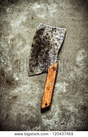 Old Hatchet For Cutting. On Stone Background.