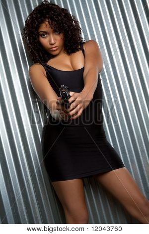 Black girl holding gun
