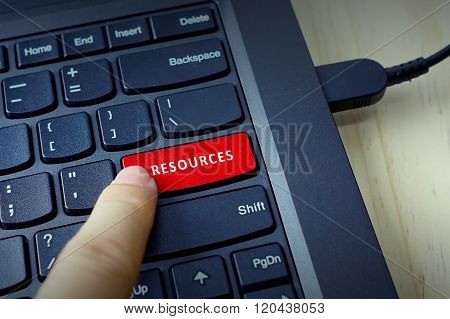 Close Up Of Finger On Keyboard Button With Resources Word
