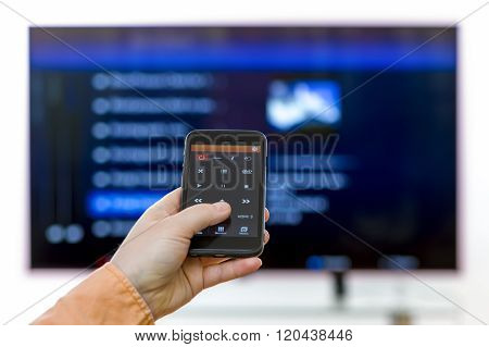Closeup On Woman Hand Holding Smartphone And Use A App With Remote Control