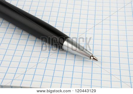 Black Ballpoint Pen On Notebook Sheet