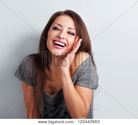 Laughing Makeup Trendy Woman With Wide Open Mouth And Closed Eyes On Blue Background