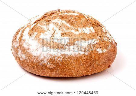 loaf of freshly baked bread floured on white background