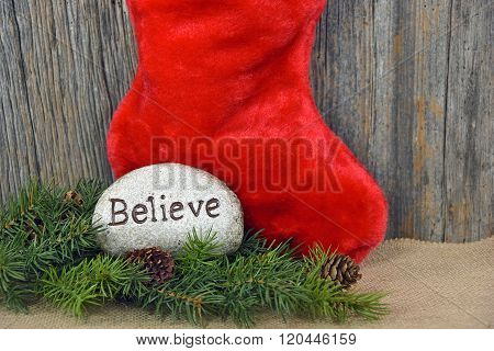 Christmas stocking with word believe