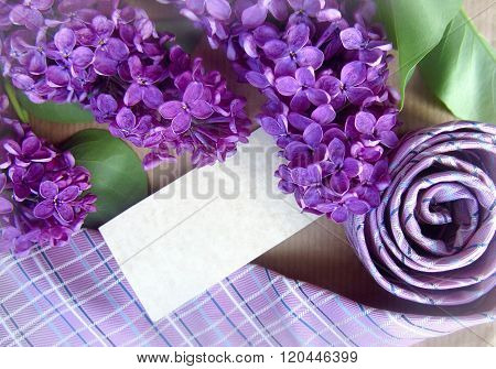 Beautiful Purple Lilac And Tie With Place For Text. Greeting Card.