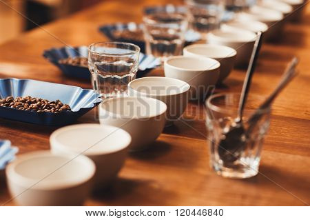 Coffee cups and beans on table ready for a tasting