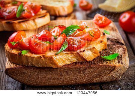Homemade Bruschetta With Cherry Tomatoes And Basil Closeup