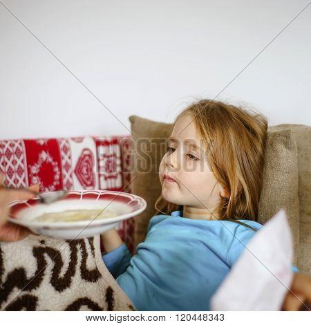 Mother Feeding Taken Ill Daughter By Semolina
