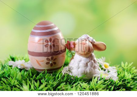 Easter Card With Cute Lamb And Egg On The Grass