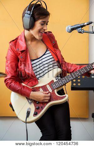 Happy Signer Playing Guitar In Recording Studio