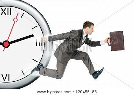 Businessman runaway from clock
