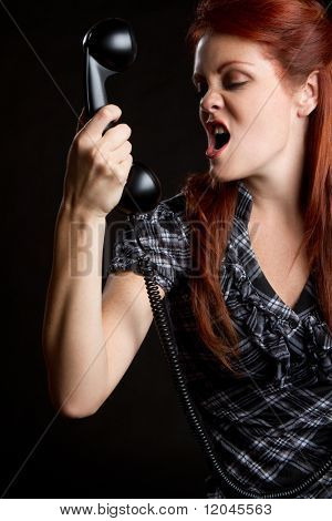 Beautiful angry redhead phone woman