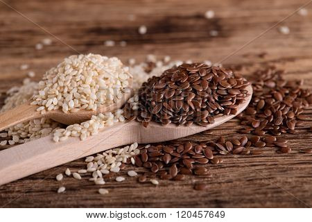 Spoon With Flax Seeds In Front Of Another One
