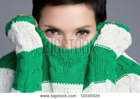 Playful winter sweater woman dressing