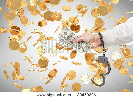 Hand With Money In Handcuffs