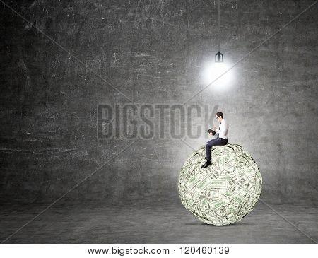 Man On Dollar Ball Reading