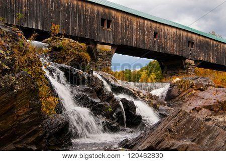 Waterfalls Under Covered Bridge in Autumn
