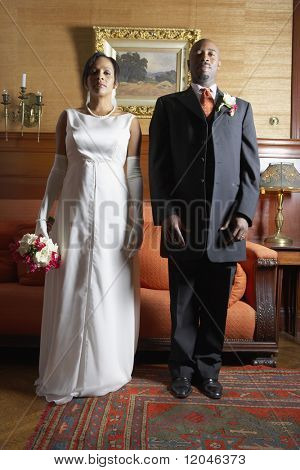 Newlywed couple posing for the camera