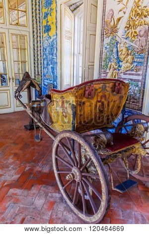 Queluz, Portugal. 18th century carriage in the Mangas or Tiles Corridor. Queluz National Palace, Portugal. Formerly used as the Summer residence by the Portuguese royal family.