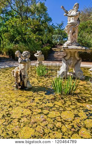 Queluz, Portugal. Fountains in the Queluz palace gardens. Decorated with sculptures of King Neptune and Tritons. Formerly used as the Summer residence by the Portuguese royal family.