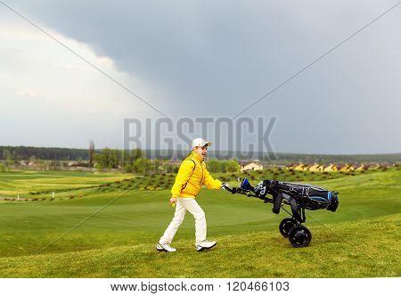 Boy playing golf