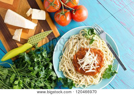 Spaghetti Plate With Cheese Over Blue Table