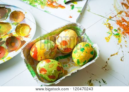 Children's creativity. The abstract colored painted eggs for Easter.